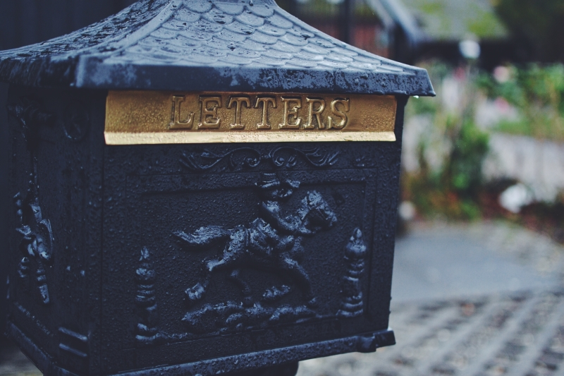 Old iron mailbox with the word 'letters' emblazoned on front